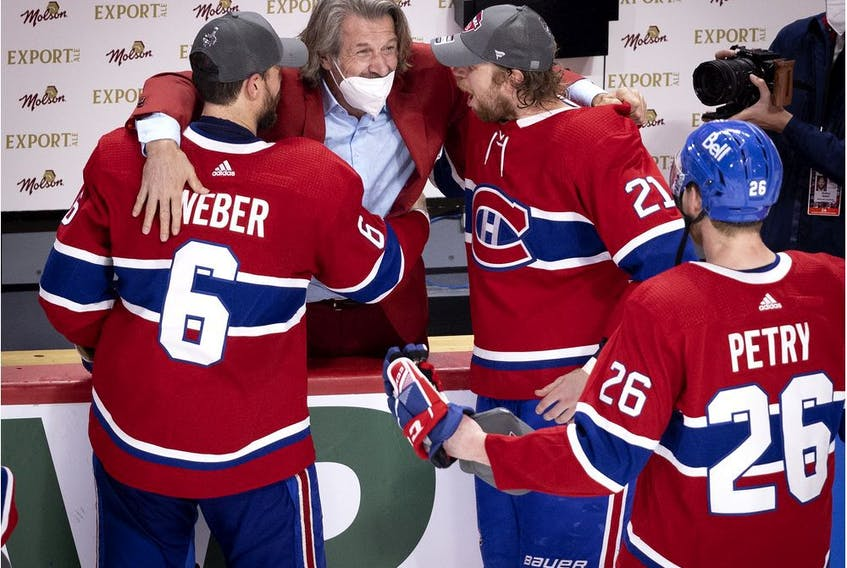 Montreal Canadiens general manager Marc Bergevin congratulates defenceman Shea Weber, centre Eric Staal defenceman Jeff Petry after the Canadiens defeated the Vegas Knights to advance to the Stanley Cup final on June 24, 2021.