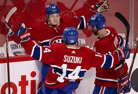 Montreal Canadiens right wing Cole Caufield (22), Montreal Canadiens center Nick Suzuki (14) and Montreal Canadiens right wing Paul Byron (41) celebrate scoring the Habs second goal against Vegas Golden Knights goaltender Robin Lehner (90) during NHL semi final game 6 in Montreal on Thursday, June 24, 2021.