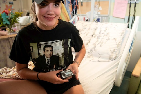 Sacha Cardinal, 17, holds the Accu-Chek DiaPort system, a highly specialized device made by Roche that infuses insulin into the abdominal cavity.