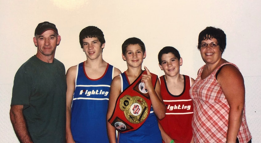 The Sanford family after the Ringside world championship in Kansas City  in 2011. From left are Dan, Devin, Wyatt, Ryan and Angela. Wyatt won his age group while Ryan placed fifth  and Devin  seventh in their respective classes.- Contributed