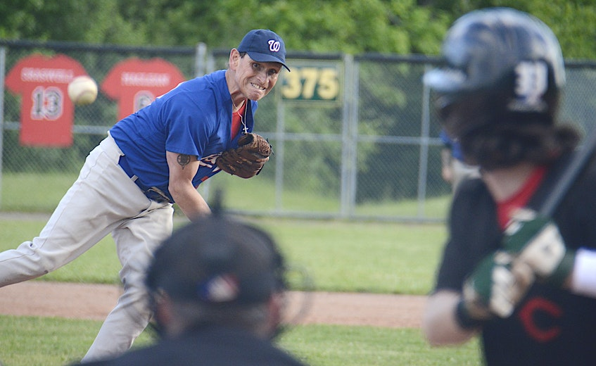 Terry MacDonald, of the Charlottetown Jays Oldtimers, throws a pitch to Morell Chevies centrefielder Bret Cheverie Wednesday, June 23, during Kings County Baseball League action at Memorial Field in Charlottetown. - Jason Malloy