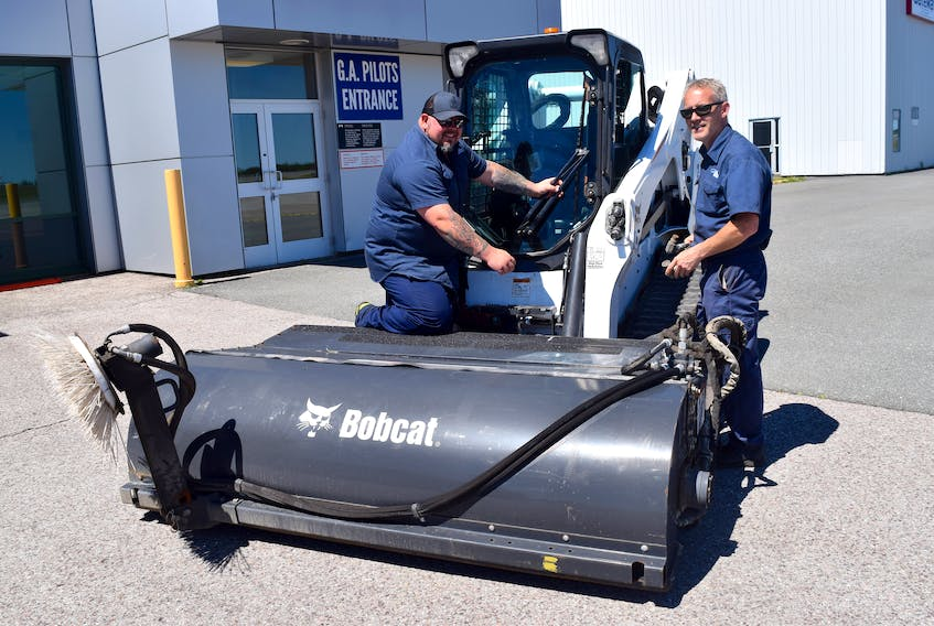 Jason Redquest, left, maintenance and aircraft rescue at the J.A. Douglas McCurdy Sydney Airport, and Steve Binder, mechanic, at the airport on Thursday. The first commercial flight into Sydney since January was expected just after midnight Saturday. Sharon Montgomery-Dupe • Cape Breton Post