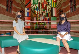 Madlyn O'Brien, left, president of Cape Breton University's 2021-22 students union, and Mandy Nguyen, right, vice-president of promotions, at the Great Hall at Cape Breton University. JESSICA SMITH/CAPE BRETON POST