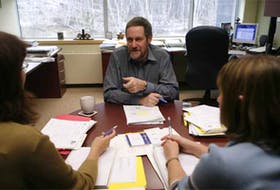Dr. Roger Strasser speaks to two Northern Ontario School of Medicine students in his Sudbury office in 2005.