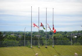 Flags fly at half-mast at UPEI on June 25. Flags at government buildings across the Island have been lowered to remember the lives of the Indigenous children killed in residential schools.