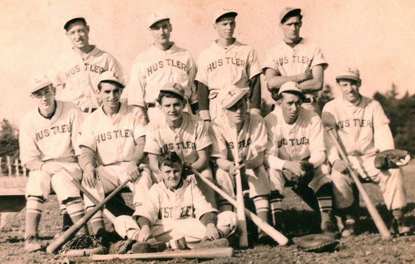 Members of the 1941 Lingan Hustler baseball team. Front row, Buddy Kelly (mascot); from left, middle row, Buck Kelly, John Willy Kelly, Tony Burke, Roddie MacNeil, Charlie Kelly and Dougie Petrie; back row, Lionel Petrie, David Boutilier, Art Kelly and Stan Burke. Contributed - Contributed