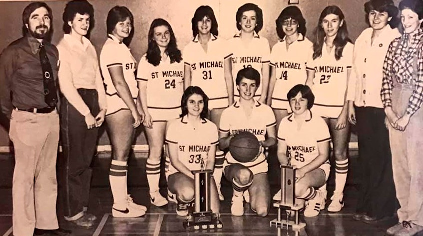 The St. Michael's High School girls basketball team from Glace Bay finished in first place in the Cape Breton 'AAA' Basketball Federation in 1979-80. The club advanced to the provincals and captured a bronze medal at the tournament. From left, front row, Gloria Taylor, Janice Coleman and Lynn Gallant; back row, Peter Campbell (coach), Kathy McKinnon, Christina MacNeil, Marie Burrows, Tracey Rogers, Kelly Phalen, Cathy Deveaux, Brenda MacDonald, Darlene O'Neill and Erin McNamara. Contributed - Contributed