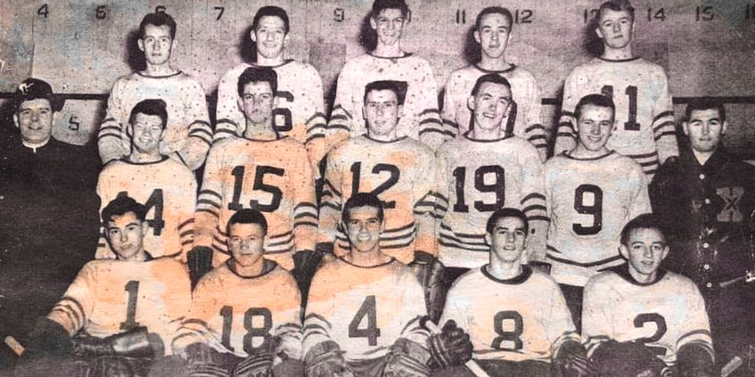The Notre Dame A.C. hockey team captured the Maritime juvenile hockey championship during the 1957-58 season. From left, front row, Gordie Stewart, Pius Hickey, Howie Collins, Paul (Jigger) Andrea and Aubrey Martell; middle row, Fr. Pius Hawley (manager), Moody Finlayson, Larry MacInnis, Ron MacDougall, Bob Gordon, Terry Jackman and Jim Doyle (head coach); back row, Bill LeBlanc, Angus MacDougall, Stan MacInnis, Austin Jessome and Bryan Cullen. Contributed - Contributed