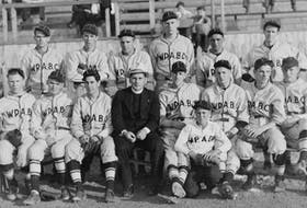 Members of the 1937 Whitney Pier Athletics Baseball Club. From left, front row, Joker LeBlanc, John Gallagher, Herman Timmons, Fr. M. M. MacDonald, Ray Murray, Jimmy MacDougall (mascot), Danny Gallivan, Jerry Kehoe and Nat Gallivan; back row, Bam Melnick, Lon Hartigan, John Willie Mombourquette, Les Topshee, Cecil Clarke and Mickey Gillis. Contributed
