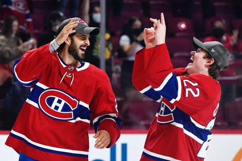 Montreal Canadiens teammates Phillip Danault, left, and Cole Caufield celebrate after winning Game 6 of the NHL semifinals against the Vegas Golden Knights at the Bell Centre.