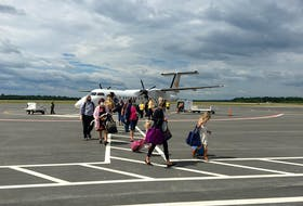 Passengers disembark the first PAL Airlines flight between St. John's, N.L. and Fredericton, N.B. (PAL Facebook photo)