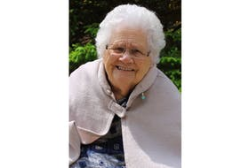 Margaret Stewart Ellis Home resident Nina Betts shows off her angel pin.