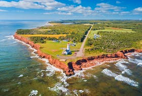 Red sandstone cliffs, rolling green hills and blue ocean awaits visitors along the Points East Coastal Drive in Prince Edward Island. - Photo courtesy Island East Tourism Group.