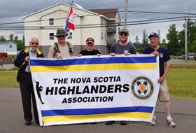 The crew was greeted by many former and current North Novies. From left to right: Former North Novie Daniel Stewart, hikers Kevin Byrne, Katie Clyburne and William Pomeroy, and Nova Scotia Highlanders Association's Pictou chapter president Gary Stewart.