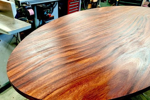 Finishing or refinishing a table top is one of the most demanding finishing tasks because the results are seen so closely. Steve finished this acacia wood table top using oil and a power buffing process.