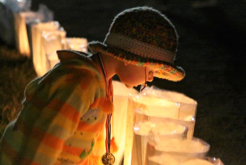 Willa Francis checks out lit-up luminaries at a previous Pictou County Relay for Life event. - Contributed  photo