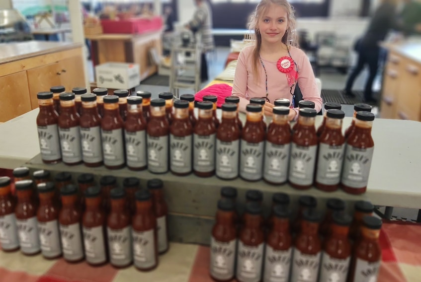 Sofi Veniott is the face of Sofi's Homestyle Bar-B-Q Sauce. The Bible Hill girl is hands-on with making the product and selling it at the Truro Farmers' Market. On May 15, she spent her ninth birthday at the market selling sauce and interacting with customers and other vendors.