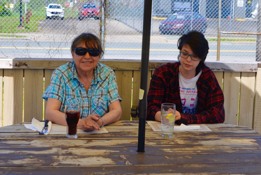 Bridget Smith, left, said she was thrilled to be able to take granddaughter Kyra Smith out for lunch on Thursday at the Steel City Sports Bar and Steakhouse. The pair enjoyed their meal on the back patio deck of the popular Townsend Street establishment. DAVID JALA/CAPE BRETON POST