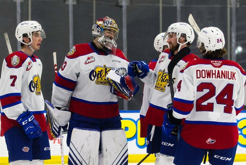 Members of the Edmonton Oil Kings celebrate their 5-0 win over the Red Deer Rebels on Friday, March 19, 2021, in Edmonton.