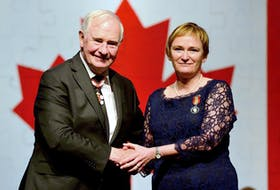 Robin McGee of Port Williams accepts the Sovereign's Medal for Volunteers from Gov. Gen. David Johnston during an awards ceremony hosted in 2016. (Master Cpl. Vincent Carbonneau, Rideau Hall)