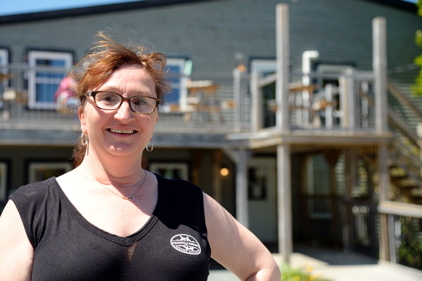 Christine Gillespie of Chafe's Landing stands in front of the Petty Harbour restaurant Thursday afternoon.— Keith Gosse/The Telegram