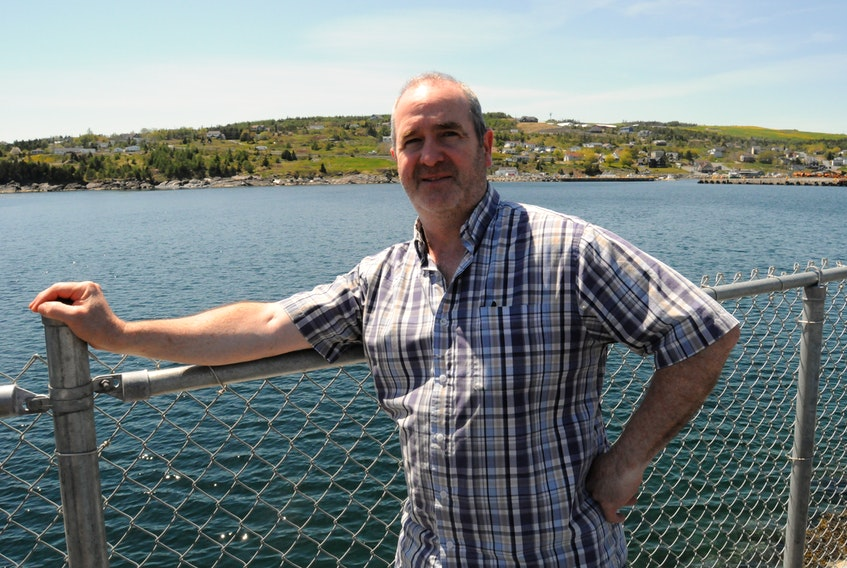 Mike Gatherall, co-owner of Gatheralls Puffin & Whale Watch in Bay Bulls, stands on their dock on the southside of Bay Bulls harbour on Thursday afternoon. Joe Gibbons • The Telegram