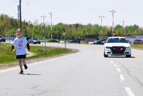 Lexi Barbour, 6, of Truro seen finishing her Marathon of Hope with a Truro Police Service Escort. Harry Sullivan Photo