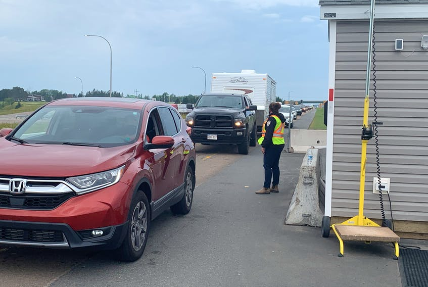 Border officials direct traffic at the Nova Scotia entry control point at Fort Lawrence, N.S. near Amherst on Wednesday.