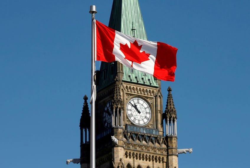 Canadian flag flies in front of the Peace Tower on Parliament Hill in Ottawa.