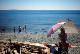 People look for ways to cool off during the 'heat dome,' currently hovering over British Columbia and Alberta as record-setting breaking temperatures scorch the province and in Victoria, British Columbia, Canada June 28, 2021.