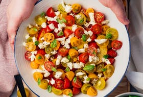 A delicious summer salad is as easy as tossing some tomatoes with olive oil, lemon juice, and fresh herbs.