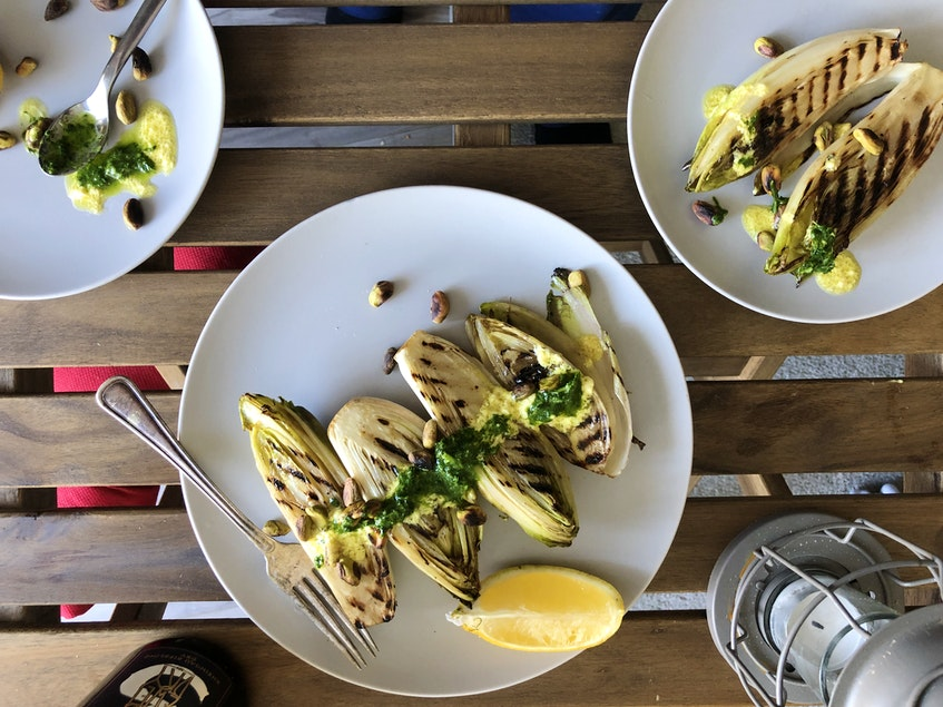 Grilled endive topped with a creamy, Caesar-like dressing makes for a modern alternative to standard salad.  - Mark DeWolf