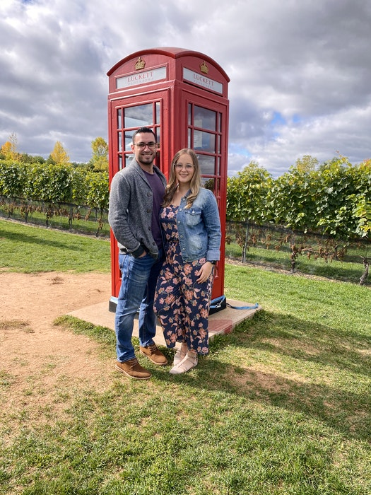 Kevin Haley and Julia Ellsworth visit the iconic red phonebooth at Luckett's Vineyard near Wolfville, N.S. If you're planning a romantic getaway, Wolfville is a great spot to visit this summer.  - Contributed