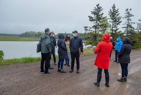 Mass Casualty Commission members gather for discussion on Portapique Road during Friday's tour of the area where the April 2020 shootings occurred.