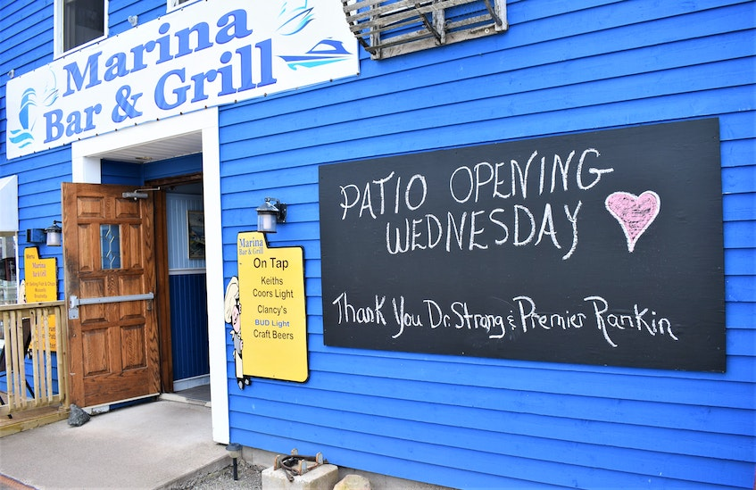 The sign out front of Marina Bar and Grill in Pictou acknowledged their patio was now opened for business. - Richard MacKenzie