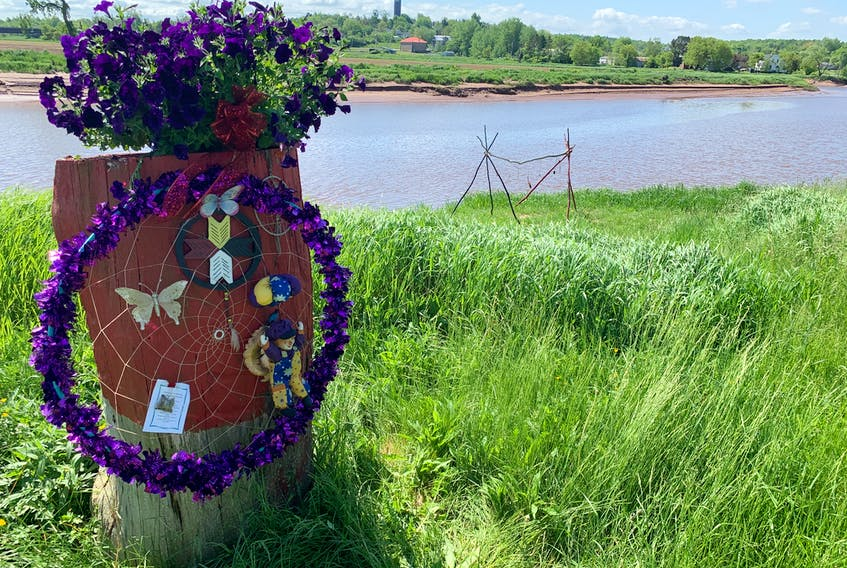 The road to the site of the former Shubenacadie Residential School is decorated with toys, stuffed animals, flowers and other symbols, in memory of the children who died in a residential school in Kamloops, B.C.