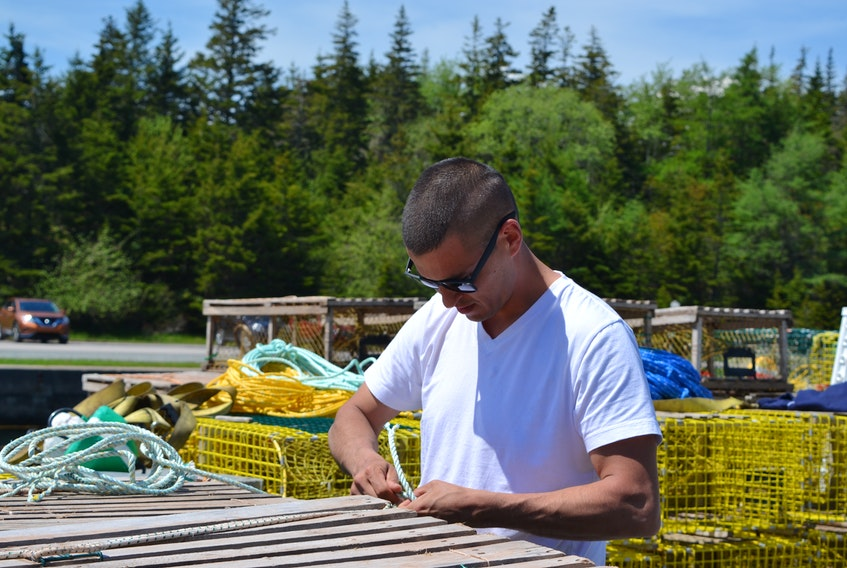 Craig Doucette from Potlotek First Nation has 70 tags issued by his community's Netukulimk Livelihood Fishery Plan. Doucette set 20 traps early Saturday morning after Potlotek and DFO reached an interim understanding that allows harvesters to fish up to 700 traps and sell their catch within the commercial season. ARDELLE REYNOLDS/CAPE BRETON POST