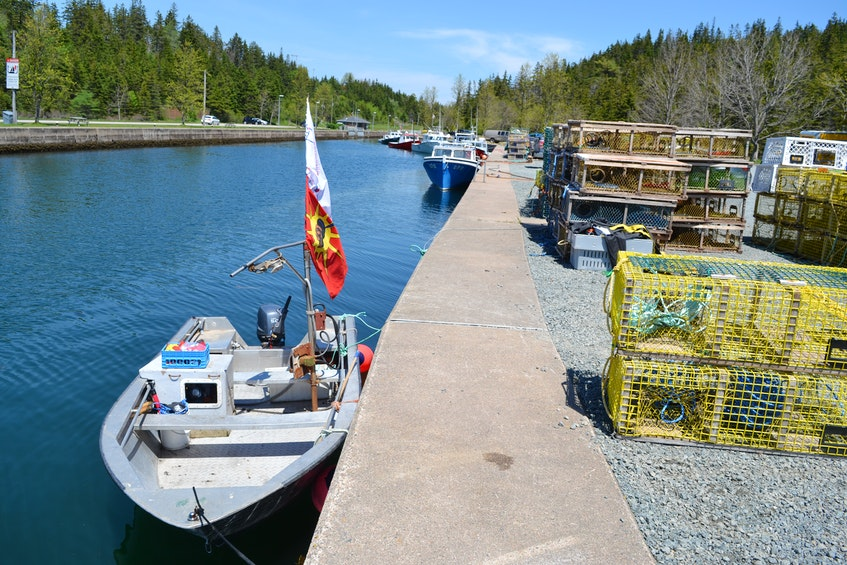 Craig Doucette's small fishing boat sits in the St. Peter's Canal Saturday afternoon, the first day of fishing under an agreement Potlotek First Nation and DFO reached to allow harvesters to fish and sell their catch this lobster season. Doucette said he  planned to wait until Sunday morning to haul in his catch. ARDELLE REYNOLDS/CAPE BRETON POST - Ardelle Reynolds