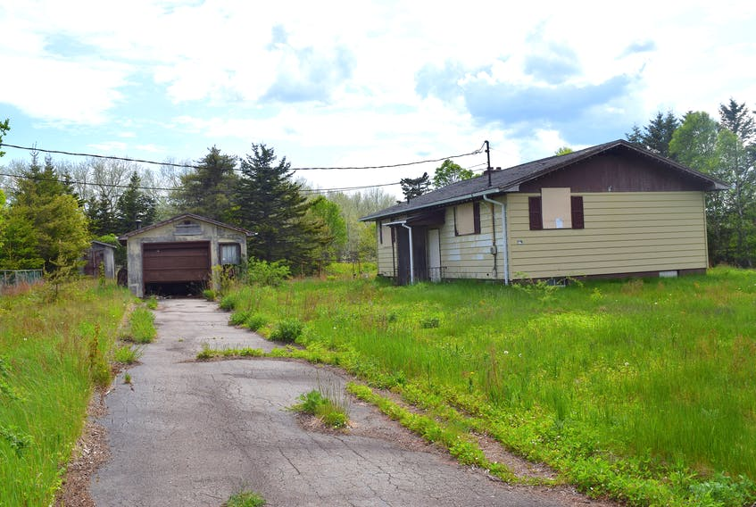 This house on Cameron's Lane, New Victoria is one of 17 unsightly properties the Cape Breton Regional Municipality will demolish this month. Sharon Montgomery-Dupe • Cape Breton Post