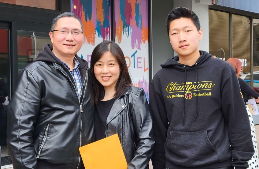 Peng Shen, centre, won the inaugural Association for Newcomers to P.E.I. award. Xiaoming Xu, left, is her husband and David Xu is her son. - Logan MacLean