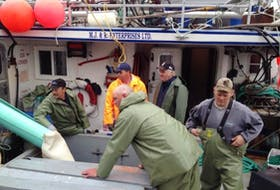 Jason Branton and crew on the deck of Gracie's Adventure during a recent crab fishing trip.