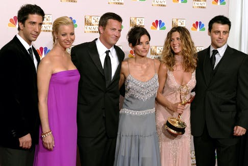 Wondering why you turn on familiar favourites to rewatch again and again? There's some actual science as to why we watch the cast of Friends over and over again. Pictured at the 54th annual Emmy Awards in 2002 are David Schwimmer, left, Lisa Kudrow, Matthew Perry, Courteney Cox Arquette, Jennifer Aniston and Matt LeBlanc. REUTERS/Mike Blake/File Photo