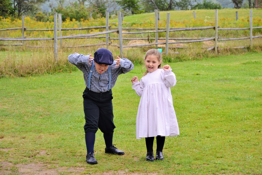 James Johnson, now nine, and his younger sister Charlotte, now eight, dress in period clothing to help their mom, Kaili Johnson, as farm helpers for the day at Sherbrooke Village. Kaili was working as the village's farmer at the time. Now, the family uses traditional techniques for small-scale farming at their homestead farm in Glenelg, NS. - Contributed