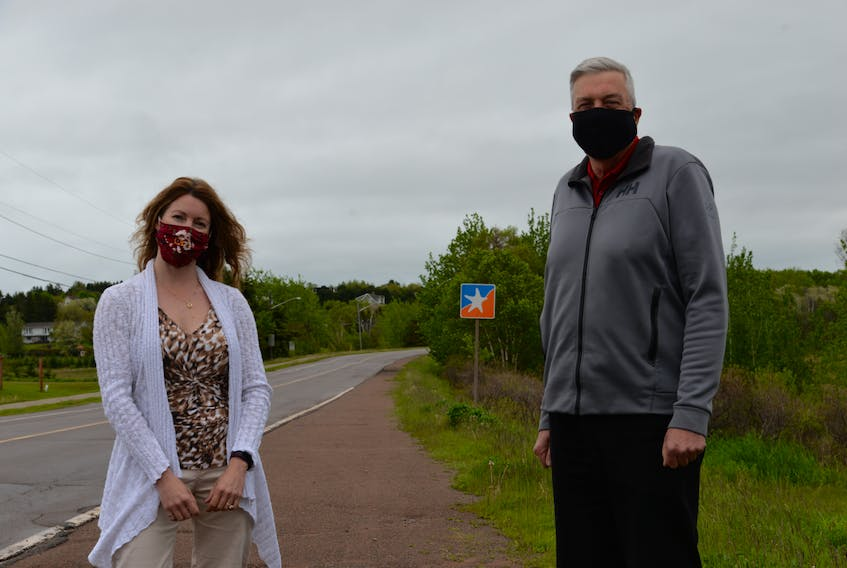 Town of Stratford project manager Jeannie Gallant, left, and Mayor Steve Ogden stand on the beach side of the Kinlock and Keppoch roads intersection near the spot where the new 2.35-kilometre Keppoch Road multi-purpose path will begin. The $1.7 million project is expected to take roughly 12 weeks, and begin in July. Terrence McEachern • The Guardian