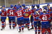 The Edmonton Oil Kings celebrate their 3-0 win over the Medicine Hat Tigers on April 22, 2021, in Edmonton.