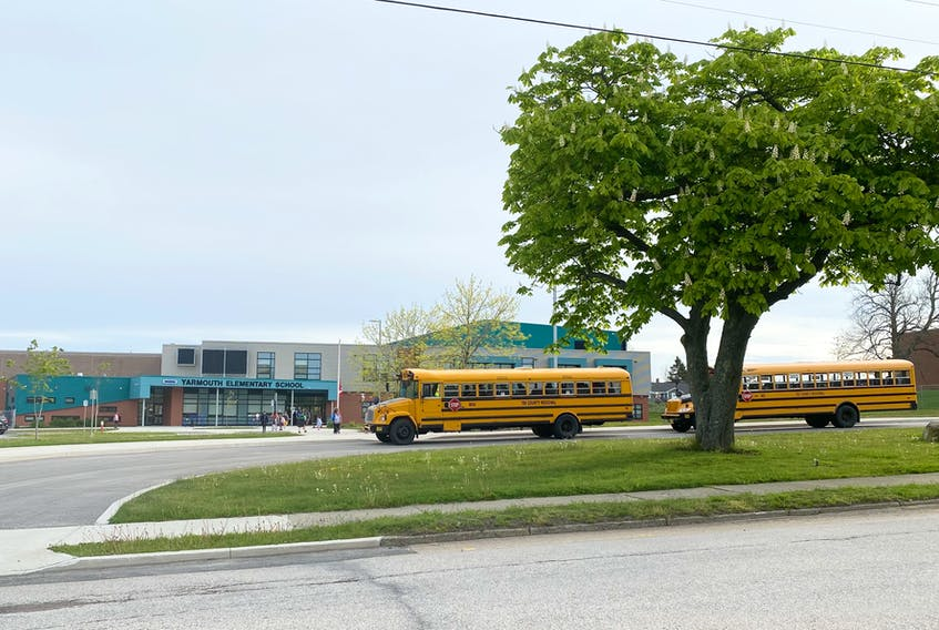 Students arrive for class at Yarmouth Elementary School one day last week after the province re-opened schools for the remainder of the school year. TINA COMEAU • TRICOUNTY VANGUARD