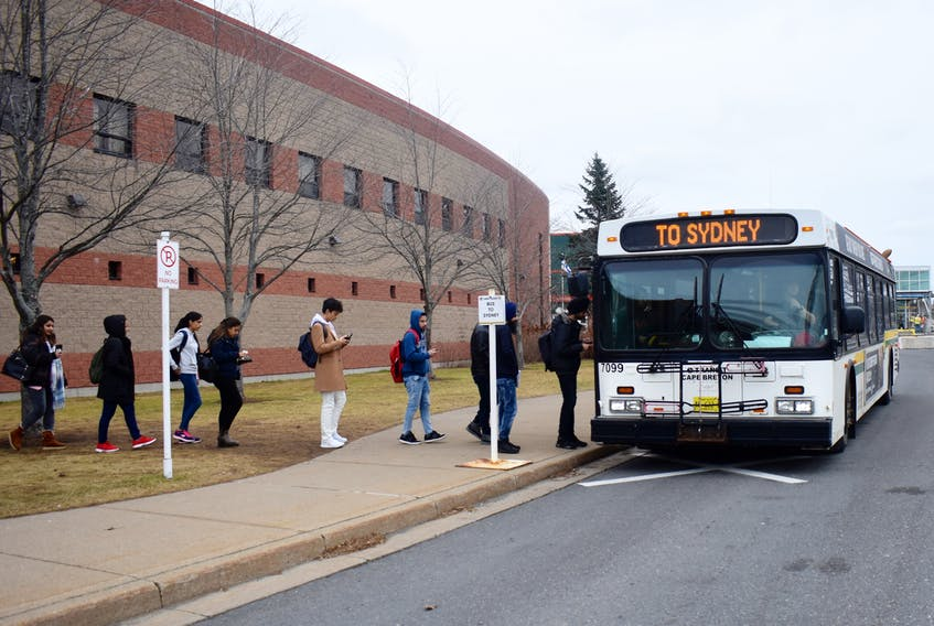 CBU students prepare to board a Sydney-bound Transit Cape Breton bus. The public transit service is expected to get $425,000 in new funding from the province's Department of Transportation and Active Transit, which will go toward the purchase of a new bus. DAVID JALA/CAPE BRETON POST FILE