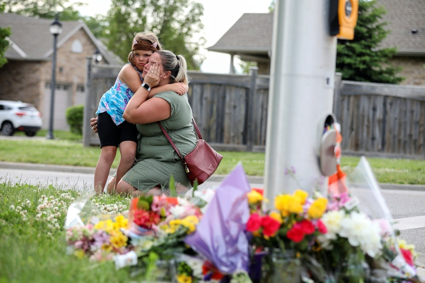 A woman and her daughter were among mourners near the memorial site in London, Ont. Dr. Dayna Lee-Baggley, a Halifax-based registered psychologist, said actively showing support helps the community cope with their grief. - Carlos Osorio/Reuters