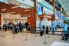 FOR PEDDLE STORY: Health staff at a COVID19 testing site, await a queue of air passengers, in the arrivals area at Halifax Stanfield Airport Tuesday Jun8, 2021.   TIM KROCHAK PHOTO