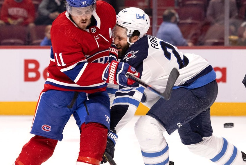 Winnipeg Jets defenceman Derek Forbort crashes face first into Montreal Canadiens right-wing Brendan Gallagher during Game 4 in Montreal on June 7, 2021.